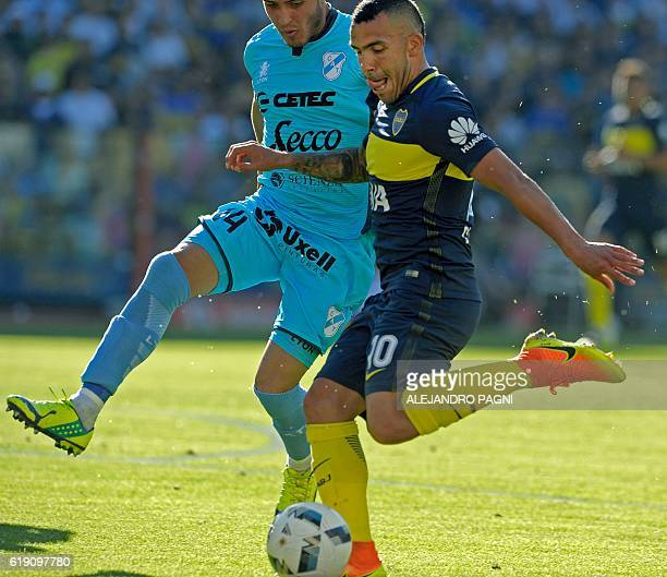 Boca Juniors' forward Carlos Tevez vies for the ball with Temperley's defender Alexis Zarate during their Argentina First Division football match at...