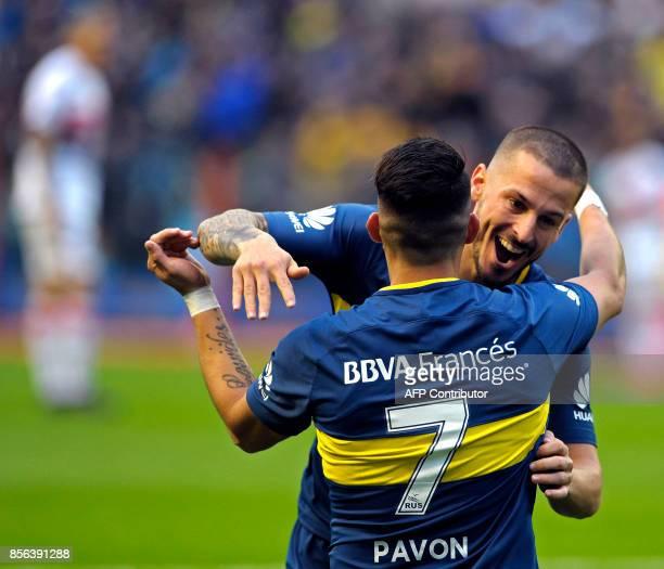 Boca Juniors' forward Cristian Pavon celebrates with teammate forward Dario Benedetto after scoring a goal against Chacarita Juniors during their...