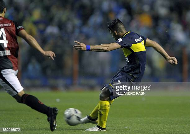 Boca Juniors' forward Cristian Pavon kicks to score the team's fourth goal against Colon during their Argentina First Division football match at La...