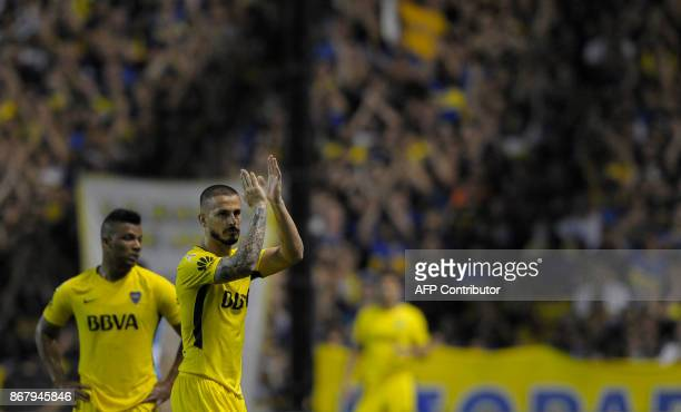 Boca Juniors' forward Dario Benedetto acknowledges the crowd as he is replaced during their Argentine First Division Superliga football match against...