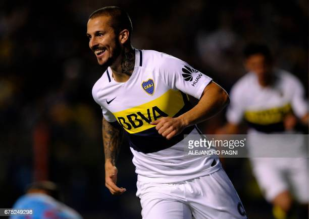 Boca Juniors' forward Dario Benedetto celebrates after scoring a goal against Arsenal during their Argentina First Division football match at La...