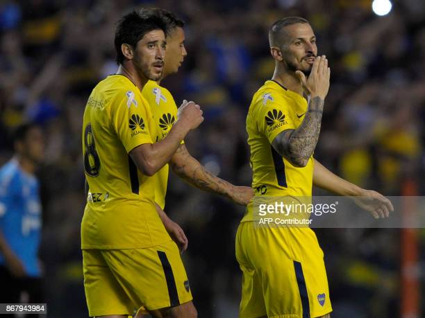 Boca Juniors' forward Dario Benedetto celebrates after scoring against Belgrano during their Argentine First Division Superliga football match at La...