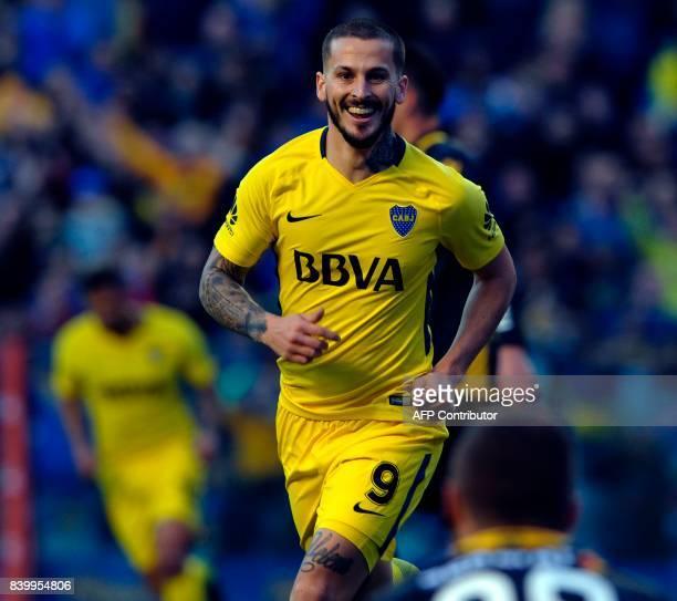 Boca Juniors' forward Dario Benedetto celebrates upon scoring against Olimpo during their Argentina First Division Superliga football match at La...