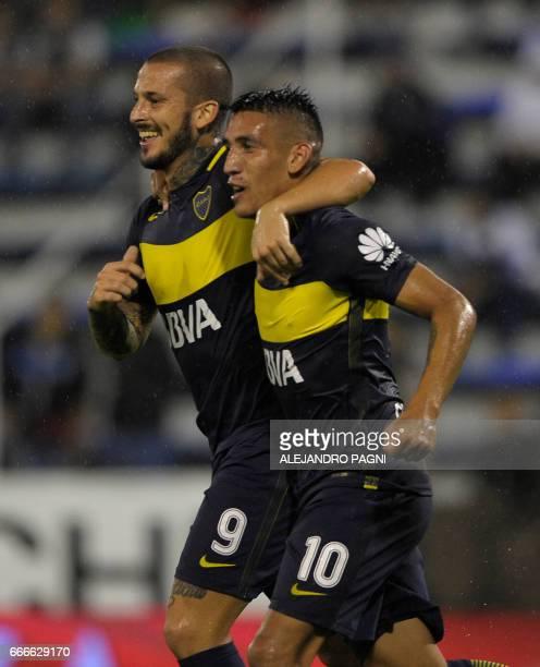 Boca Juniors' forward Dario Benedetto celebrates with teammate forward Ricardo Centurion after scoring against Velez Sarsfield during their Argentina...