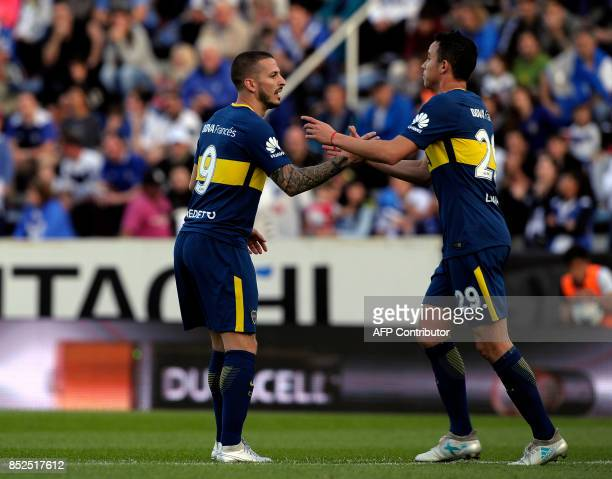 Boca Juniors' forward Dario Benedetto celebrates with teammate defender Leonardo Jara after scoring against Velez Sarsfield during their Argentina...