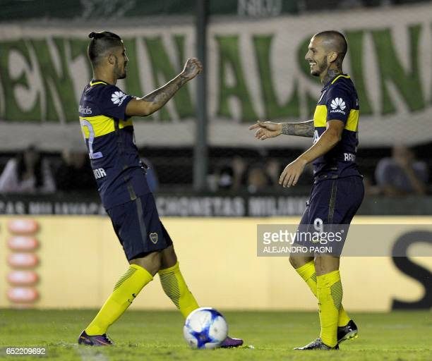 Boca Juniors' forward Dario Benedetto celebrates with teammate midfielder Oscar Benitez after scoring the team's second goal against Banfield during...