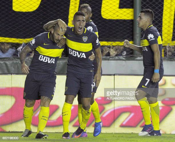 Boca Juniors' forward Dario Benedetto celebrates with teammates after scoring against Banfield during their Argentina First Division football match...