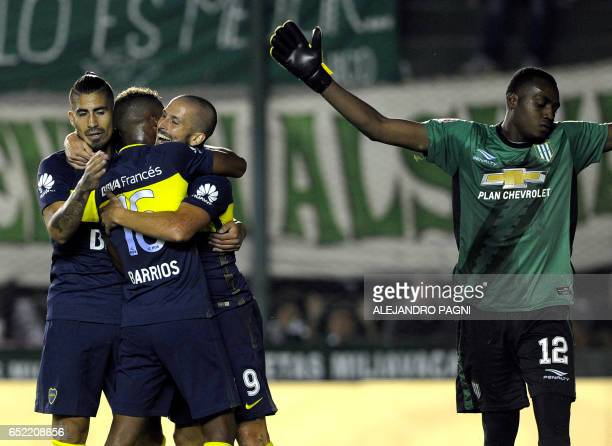 Boca Juniors' forward Dario Benedetto celebrates with teammates after scoring the team's second goal against Banfield during their Argentina First...