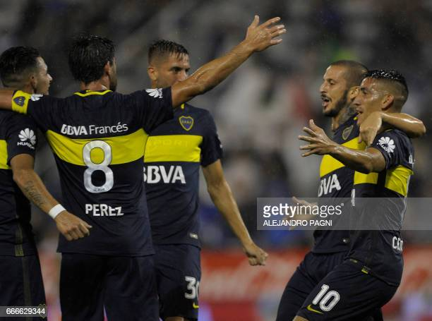 Boca Juniors' forward Dario Benedetto celebrates with teammates after scoring a goal against Velez Sarsfield during their Argentina First Divsion...