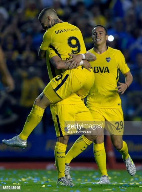 Boca Juniors' forward Dario Benedetto celebrates with teammates after scoring against Belgrano during their Argentine First Division Superliga...