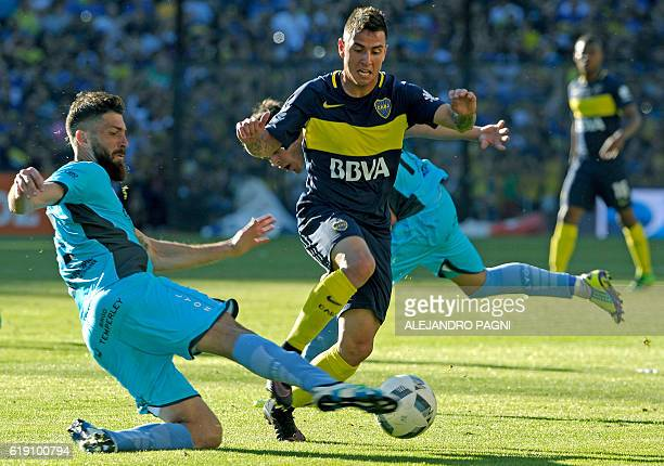 Boca Juniors' forward Nazareno Solis vies for the ball with Temperley's defenders Ignacio Bogino and Alexis Zarate during their Argentina First...