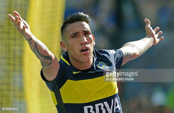 Boca Juniors' forward Ricardo Centurion celebrates after scoring a goal against Sarmiento during their Argentina First Division football match at La...