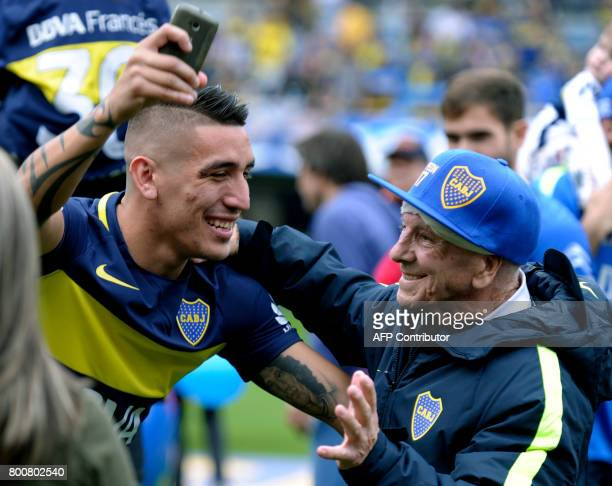 Boca Juniors forward Ricardo Centurion celebrates with an assistant after their team wins Argentina's first division football championship at La...