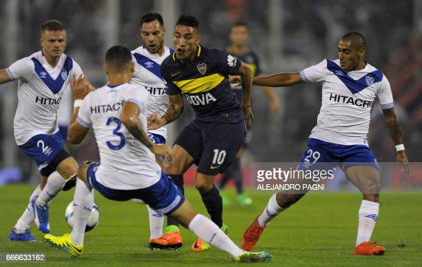 Boca Juniors' forward Ricardo Centurion controls the ball between Velez Sarsfield's player during their Argentina First Divsion football match at...