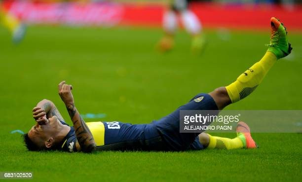Boca Juniors' forward Ricardo Centurion gestures in pain during the Argentina first division football match against River Plate at the La Bombonera...