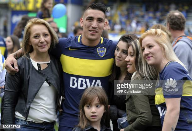 Boca Juniors' forward Ricardo Centurion poses with his family after his team defeated Union and won Argentina's first division football championship...