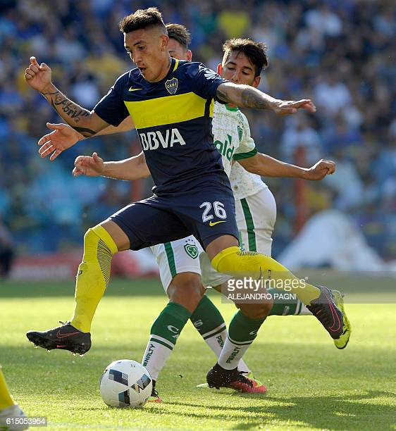 Boca Juniors' forward Ricardo Centurion vies for the ball with Sarmiento's midfielder Jonathan Santana during their Argentina First Division football...