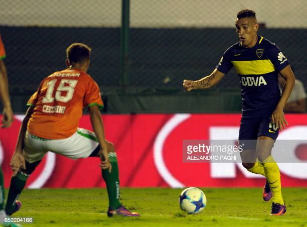 Boca Juniors' forward Ricardo Centurion vies for the ball with Banfield's midfielder Alexis Castro during their Argentina First Division football...