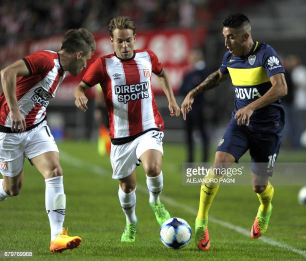 Boca Juniors' forward Ricardo Centurion vies for the ball with Estudiantes' defender Facundo Sanchez during their Argentina First Divsion football...