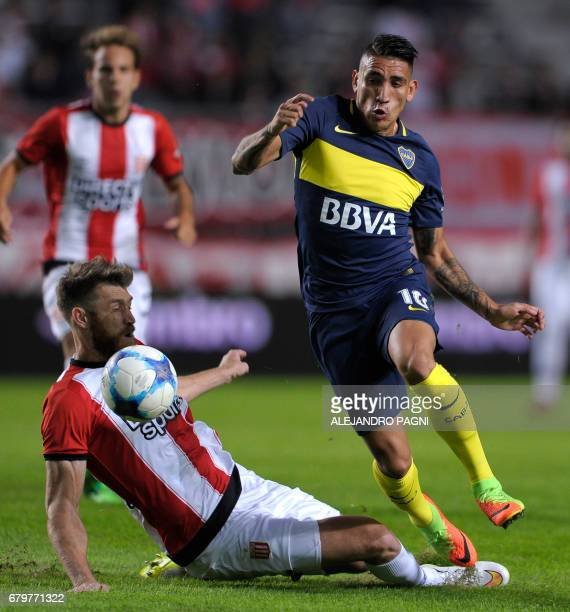 Boca Juniors' forward Ricardo Centurion vies for the ball with Estudiantes' defender Jonatan Schunke during their Argentina First Divsion football...