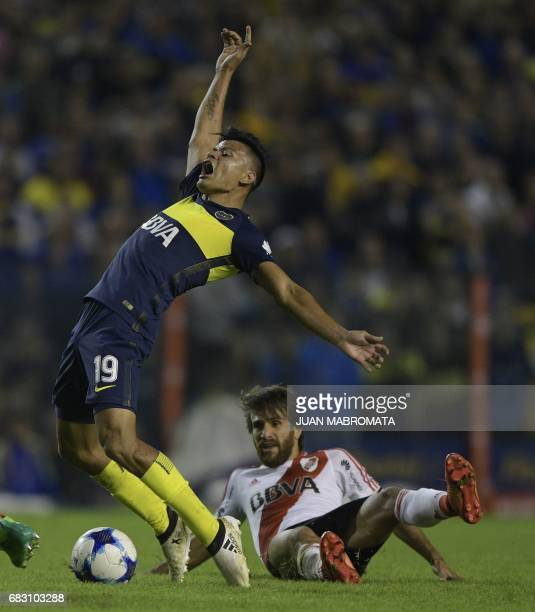 Boca Juniors' forward Walter Bou is fouled by River Plate's midfielder Leonardo Ponzio during their Argentina first division football match at the La...