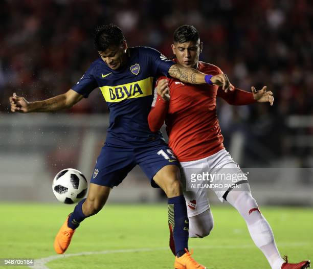 Boca Juniors' forward Walter Bou vies for the ball with Independiente's defender Alan Franco during their Argentina First Division Superliga football...