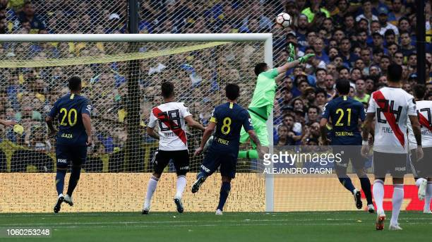 Boca Juniors' goalkeeper Agustin Rossi dives for the ball during the first leg match of the allArgentine Copa Libertadores final against River Plate...