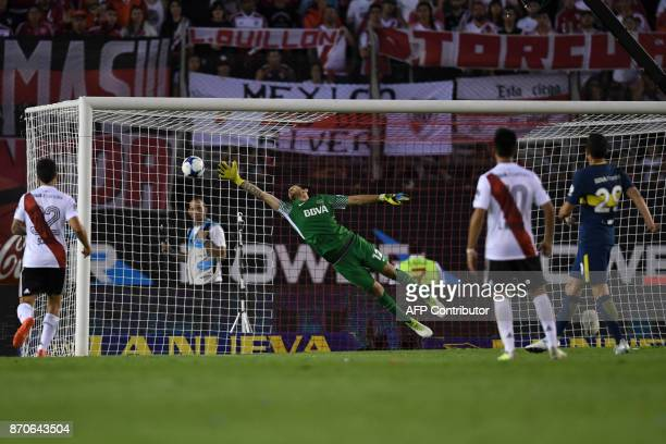 Boca Juniors' goalkeeper Agustin Rossi fails to stop a goal during the Argentine derby match against River Plate in the Superliga first division...