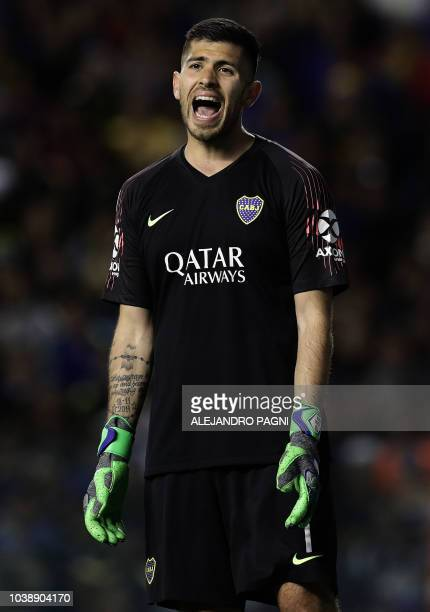 Boca Juniors' goalkeeper Agustin Rossi shouts to teammates during an Argentina First Division Superliga football match against River Plate at La...