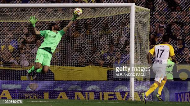 Boca Juniors' goalkeeper Agustin Rossi stops the ball from Rosario Central's forward German Herrera during their Argentina First Division Superliga...