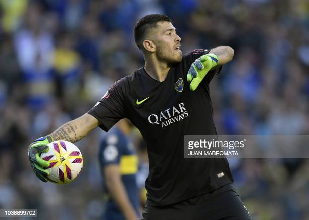 Boca Juniors' goalkeeper Agustin Rossi throws the ball during an Argentine first division Superliga football match against River Plate at 'La...