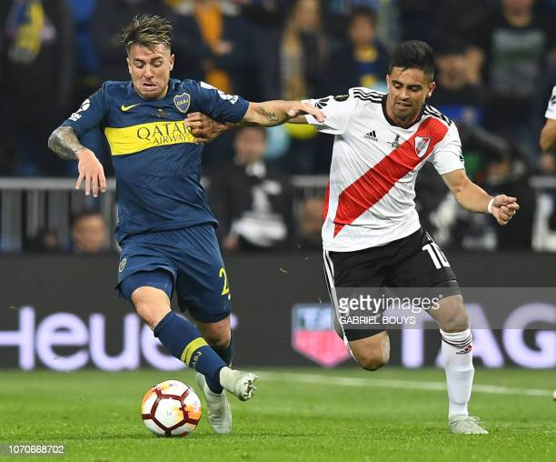 TOPSHOT Boca Juniors' Julio Buffarini and River Plate's Gonzalo Martinez vie for the ball during the second leg match of their allArgentine Copa...