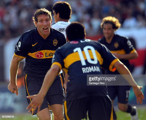 Boca Junior´s Martin Palermo celebrates with Juan Roman Riquelme a scored goal during their Argentinean Championship Primera A match against River...