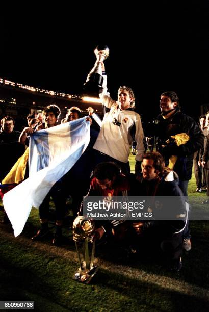 Boca Juniors' match winner Martin Palermo lifts his Man of the Match trophy