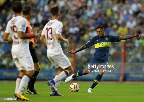 Boca Juniors' midfielder Agustin Almendra kicks the ball during the Argentina First Division Superliga football match against Lanus at La Bombonera...