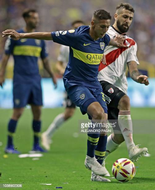 Boca Juniors' midfielder Agustin Almendra vies for the ball with River Plate's forward Lucas Pratto during an Argentina First Division Superliga...