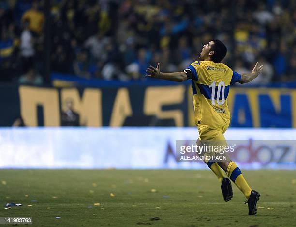 Boca Juniors' midfielder Juan Roman Riquelme celebrates after scoring the team's second goal against Lanus during their Argentina First Division...