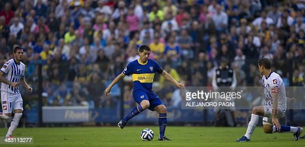 Boca Juniors' midfielder Juan Roman Riquelme controls the ball during their Argentine First Division football match against Godoy Cruz at the...