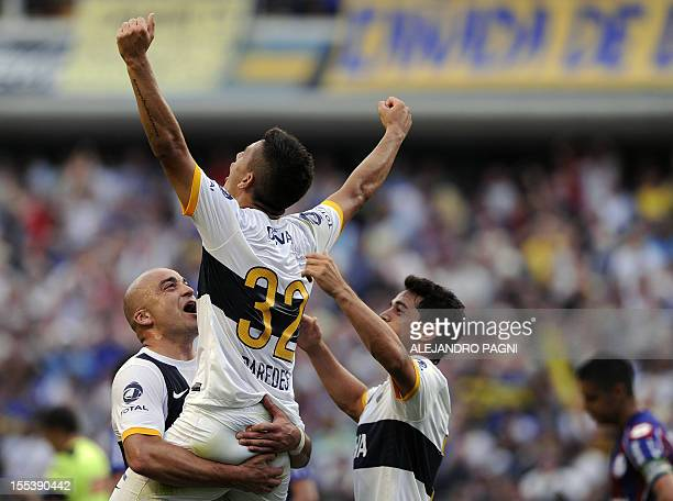 Boca Juniors' midfielder Leandro Paredes celebrates with teammates after scoring the team's second goal against San Lorenzo during their Argentine...