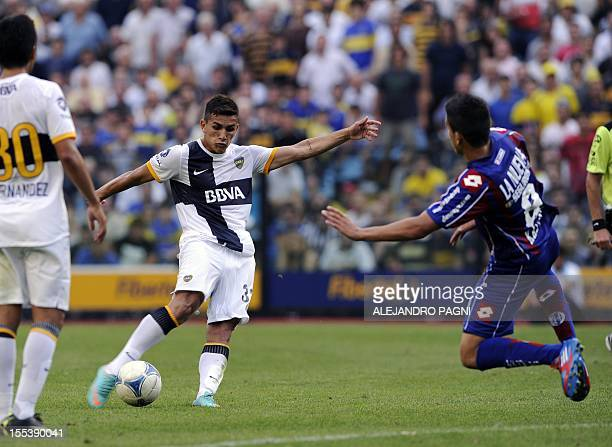 Boca Juniors' midfielder Leandro Paredes shoots to score the team's second goal against San Lorenzo during their Argentine First Division football...