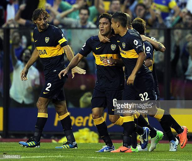 Boca Juniors' midfielder Matias Caruzzo celebrates with his teammate midfielder Leandro Paredes after scoring against Racing Club during their...