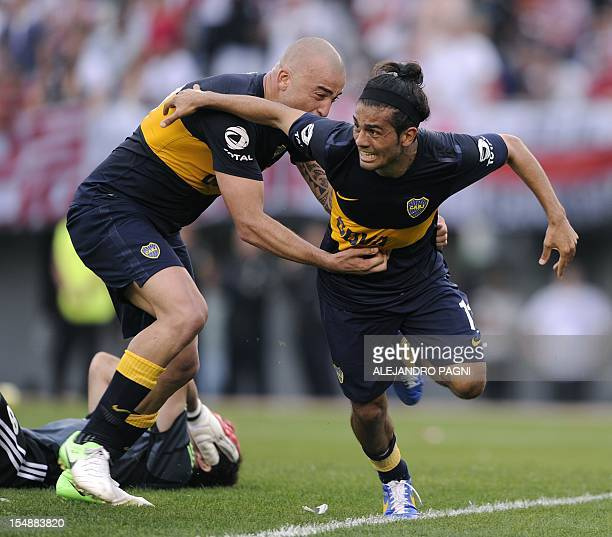 Boca Juniors' midfielder Walter Erviti celebrates after scoring a goal against River Plate during their Argentine First Division football match at...