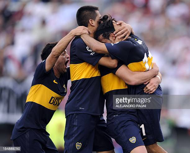 Boca Juniors' midfielder Walter Erviti celebrates with his teammates after scoring his team's second goal against River Plate during their Argentine...