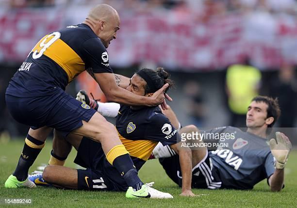 Boca Juniors' midfielder Walter Erviti celebrates with his temmate forward Santiago Silva after scoring his team's second goal against River Plate...