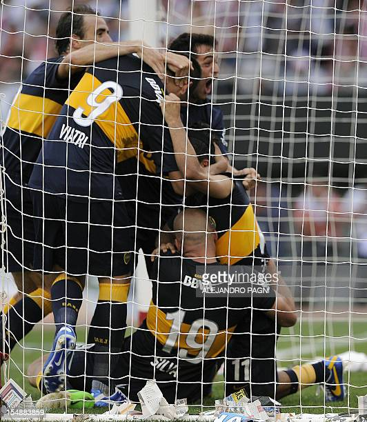 Boca Juniors' midfielder Walter Erviti celebrates with temmates after scoring his team's second goal against River Plate during their Argentine First...