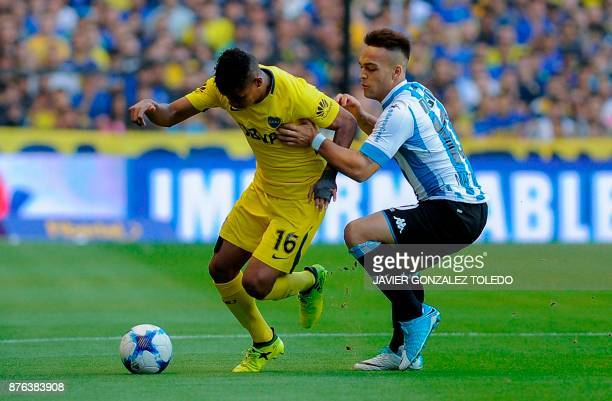 Boca Juniors' midfielder Wilmar Barrios vies for the ball with Racing's forward Lautaro Martinez during the Superliga first division tournament match...