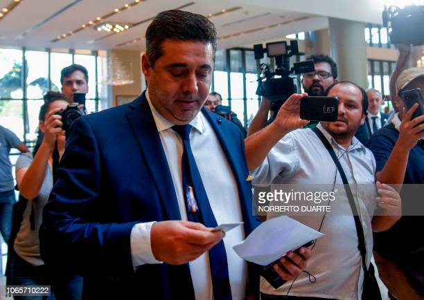 Boca Juniors' president Daniel Angelici arrives at the hotel of the Conmebol South American football's governing body in Luque near Asuncion on...