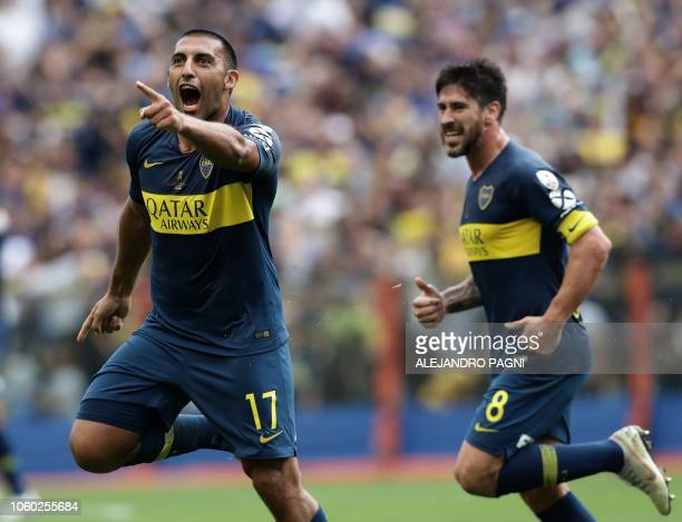 Boca Juniors' Ramon Abila celebrates after scoring against River Plate during their first leg match of the allArgentine Copa Libertadores final at La...