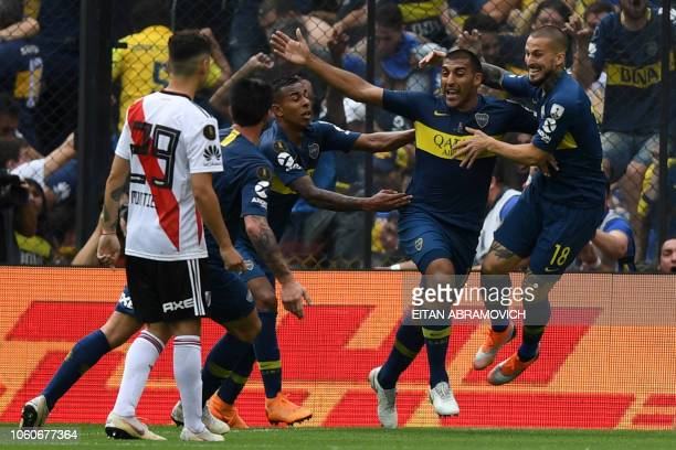 Boca Juniors' Ramon Abila celebrates with teammates after scoring against River Plate during the first leg match of the allArgentine Copa...