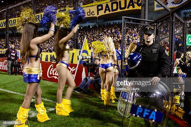 Boca Juniors soccer team cheerleaders are seen as they leave after performing during the match between Boca Junior and Godoy Cruz at La Bombonera...